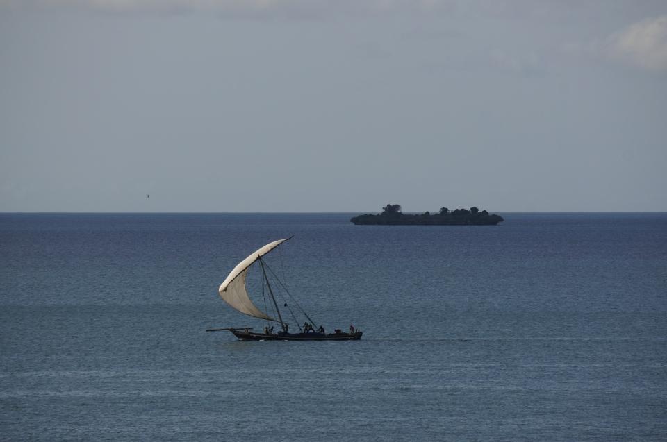 A dhow sets sail off the coast of Zanzibar (2014).